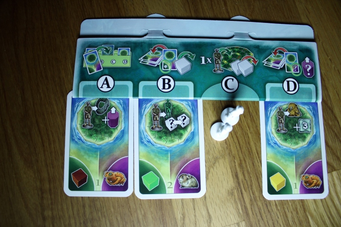 Card holder in La Isla showing the A, B, C, and D phases. Image from Meople's Magazine (CC BY-NC-SA 2.0)