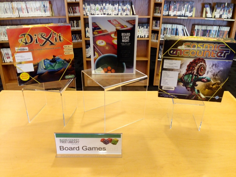 Clear Signage, prominent display, library event tie-ins. Only two games left and Dixit was checked out 15 minutes after the picture...poor Cosmic Encounters